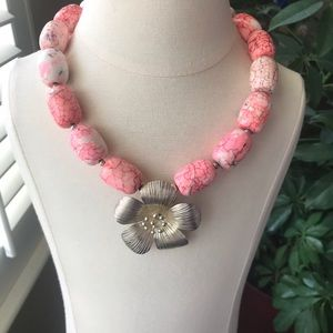 Custom made necklace with flower pendant.